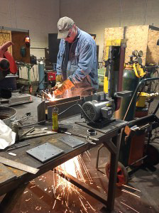 Instructor David Hall working on a welding project