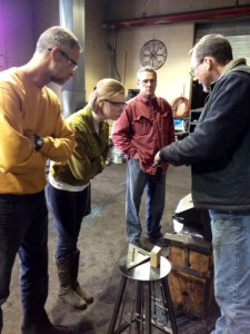 Blacksmithing instructor with students